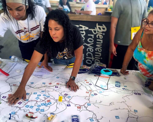 Three women participate in a mapping project