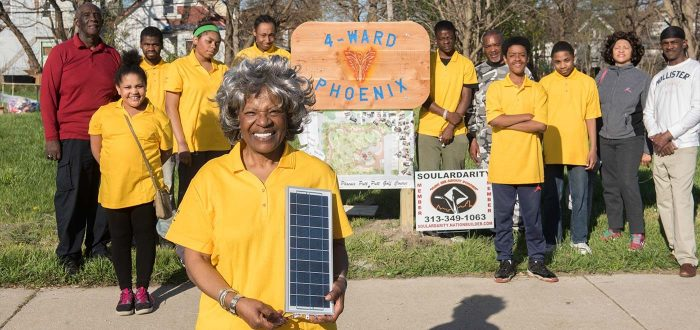 4 Ward Phoenix group - woman with small solar panel