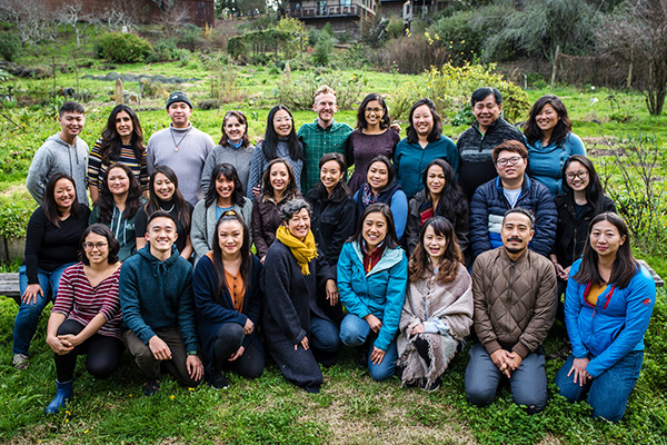 A group of Asian American and Pacific Islanders working together